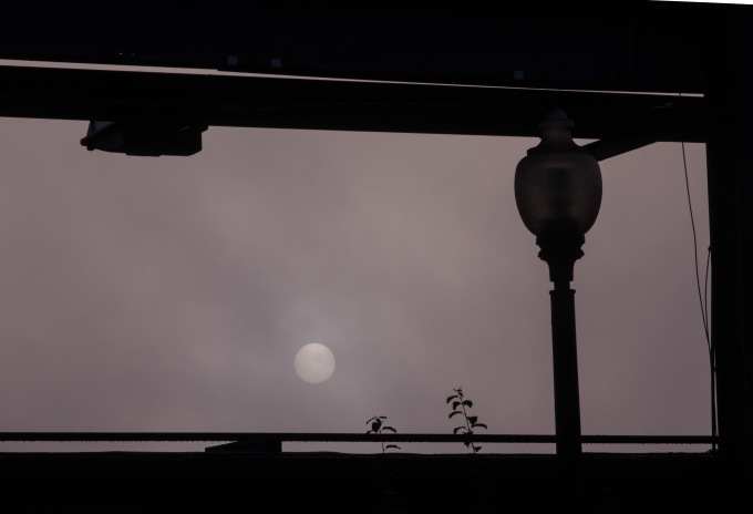 Lamp, Bridge, and Sun Through the Fog