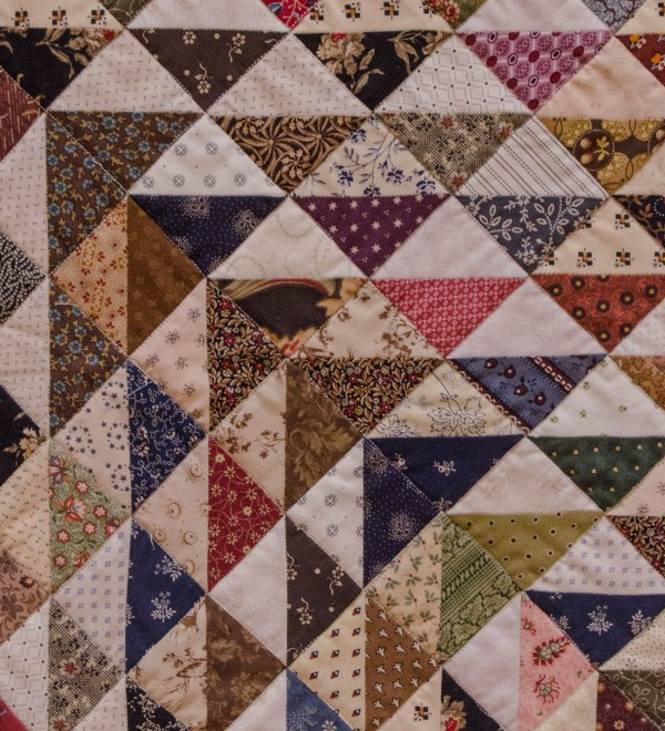Some quilts use very small (1-inch here) blocks. Here each tiny block is made of two different fabrics.